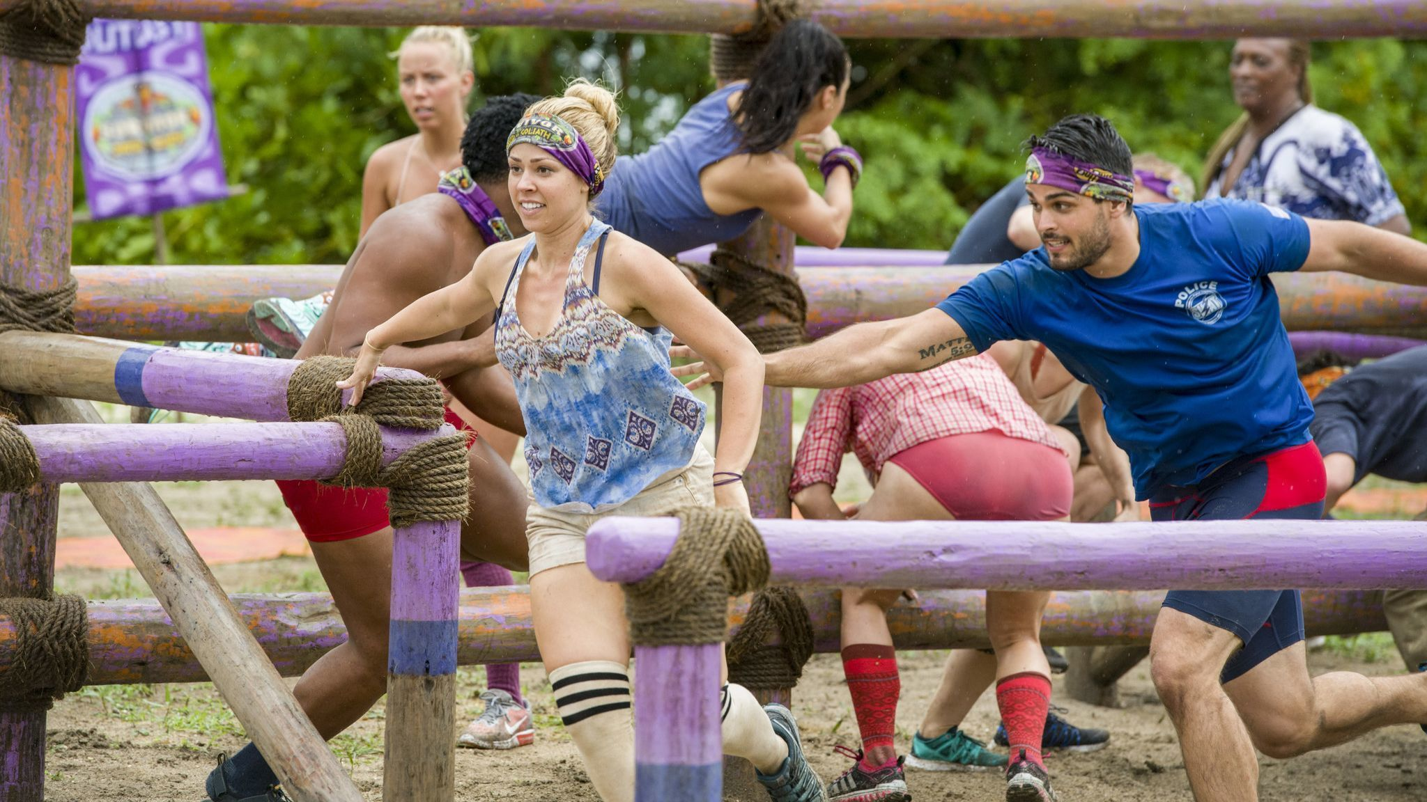 Kara Kay, foreground and left, competes in a 'Survivor: David vs. Goliath' challenge.