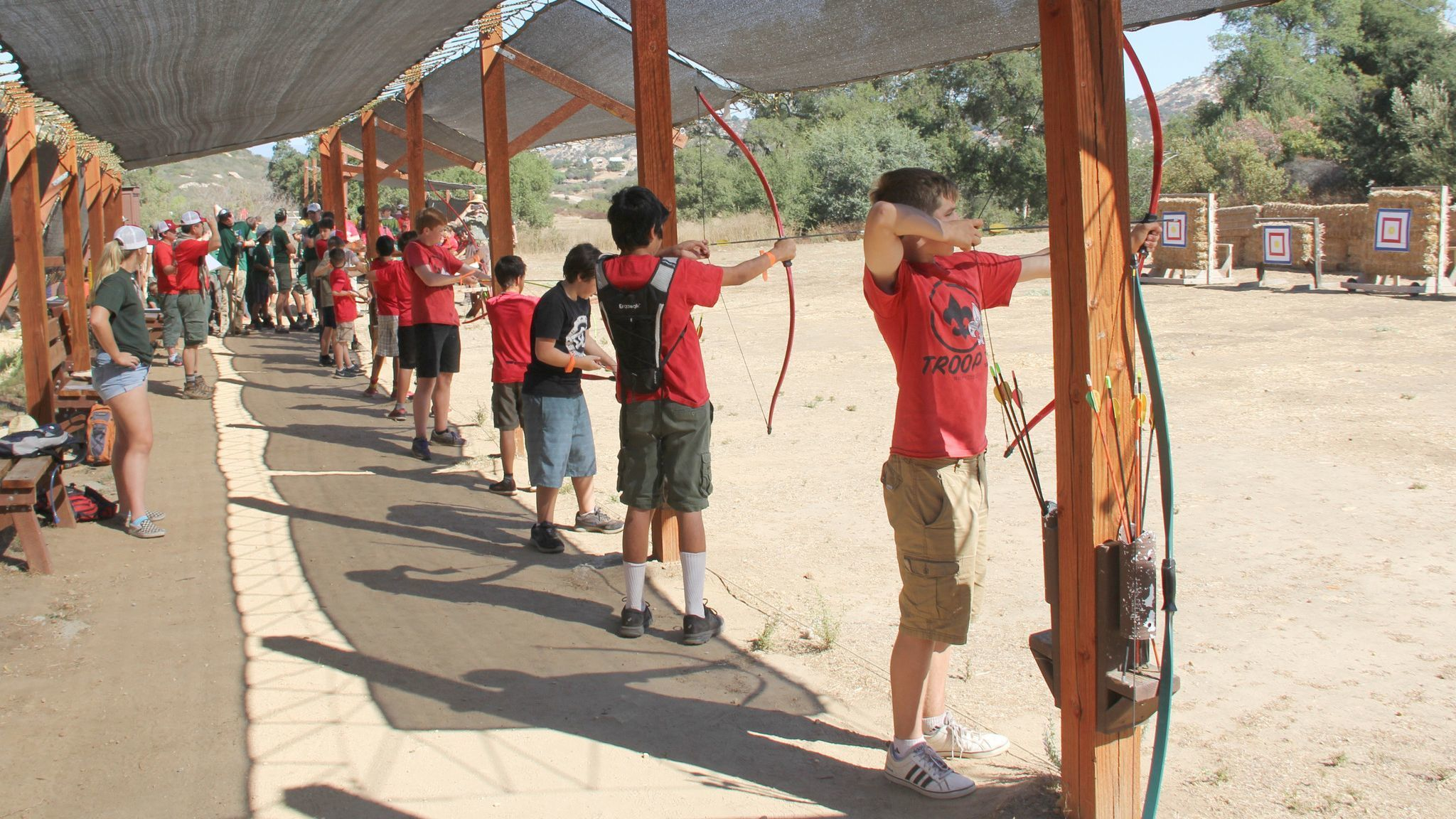 Boy Scouts practice archery skills at the annual Camporee.