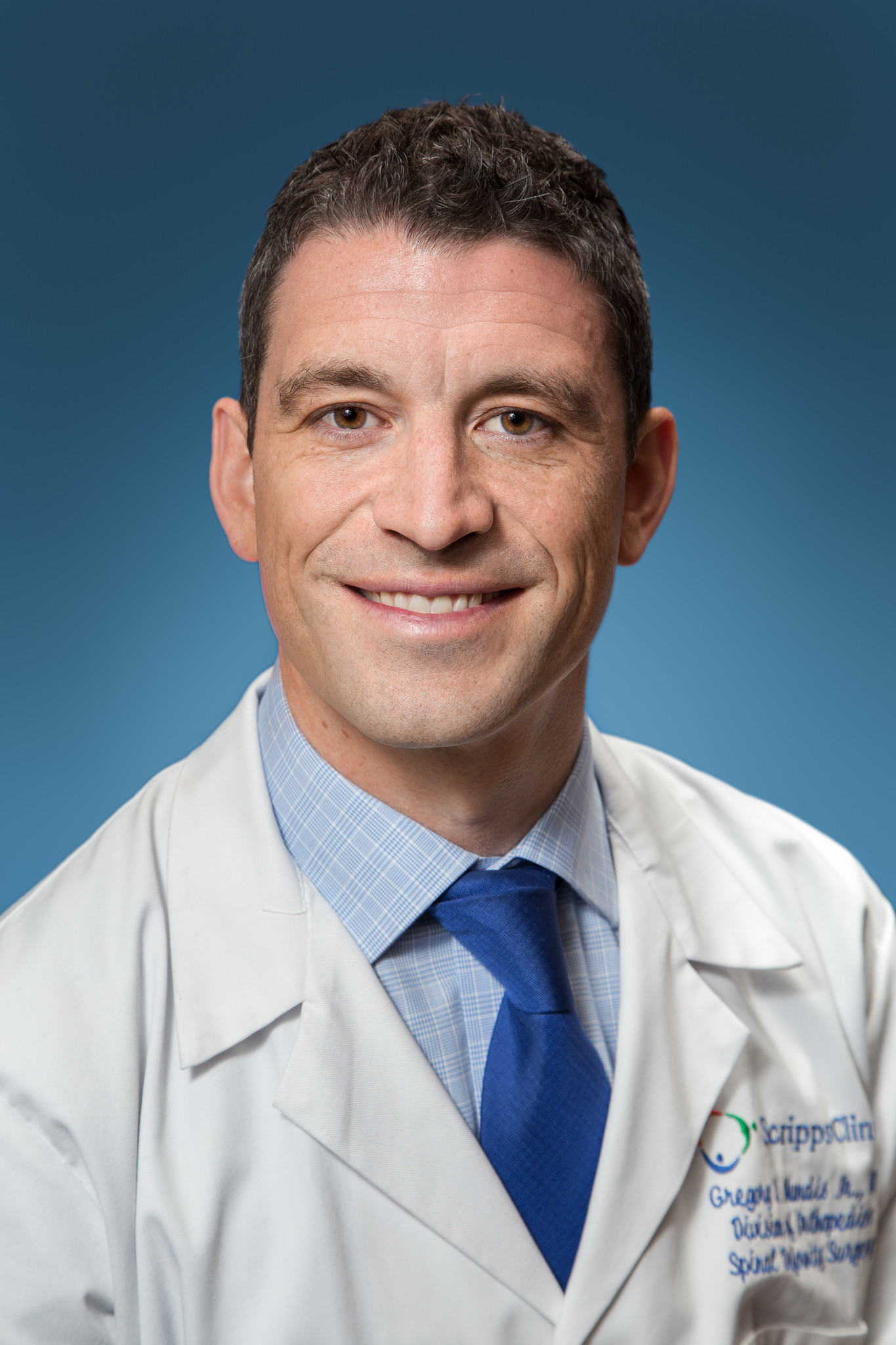 Dr. Gregory Mundis