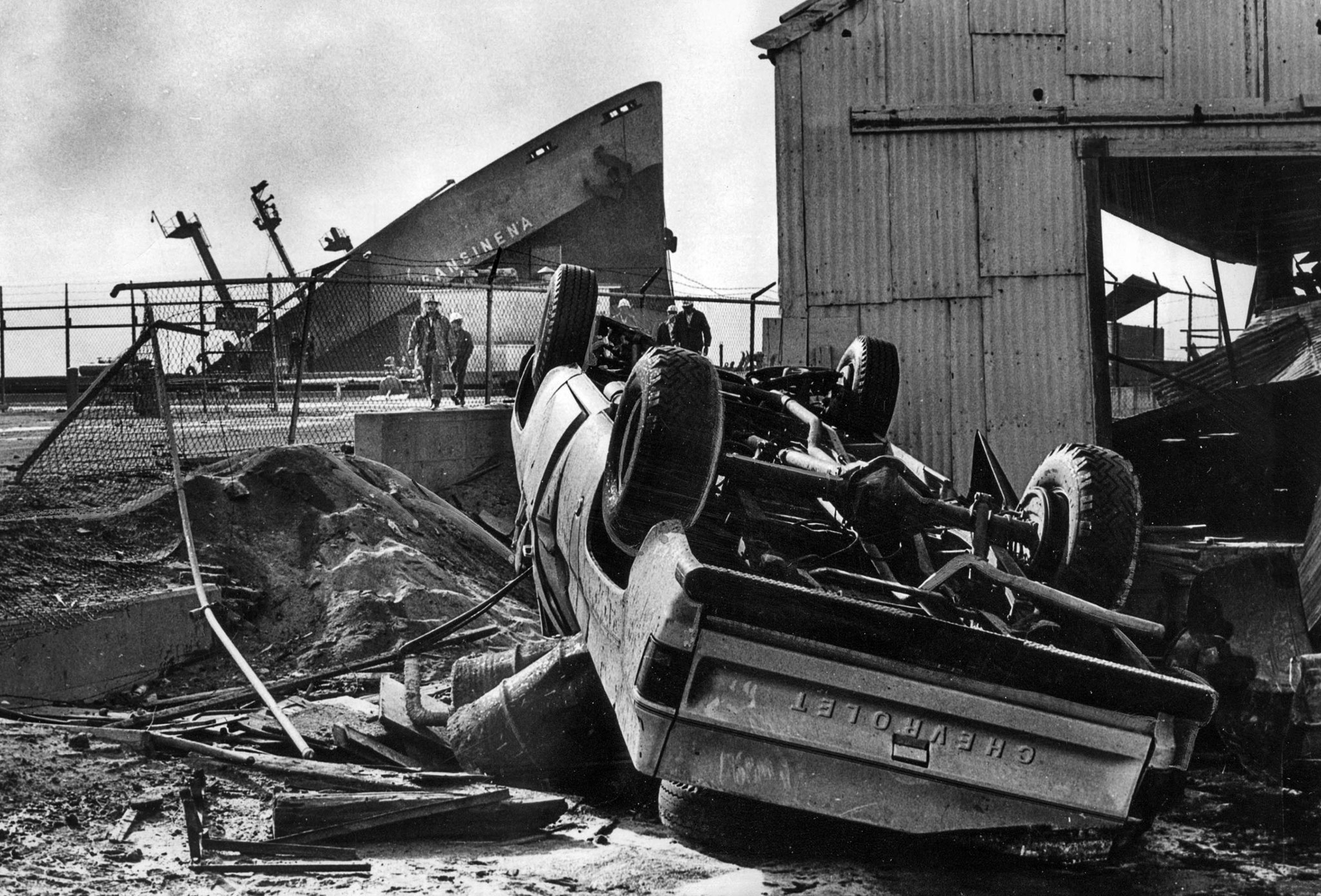 Dec. 18, 1976: An overturned truck sits overturned by the explosion of the tanker Sansinena, whose b
