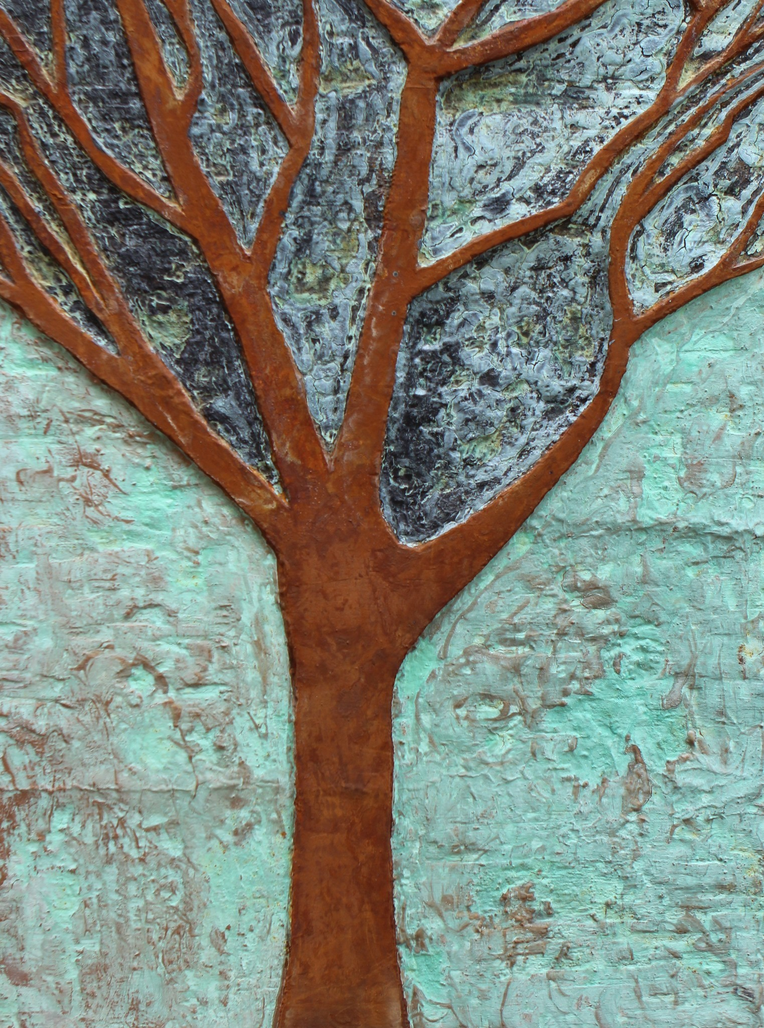Ed Whitmore's signature piece is the bas-relief tree of life.