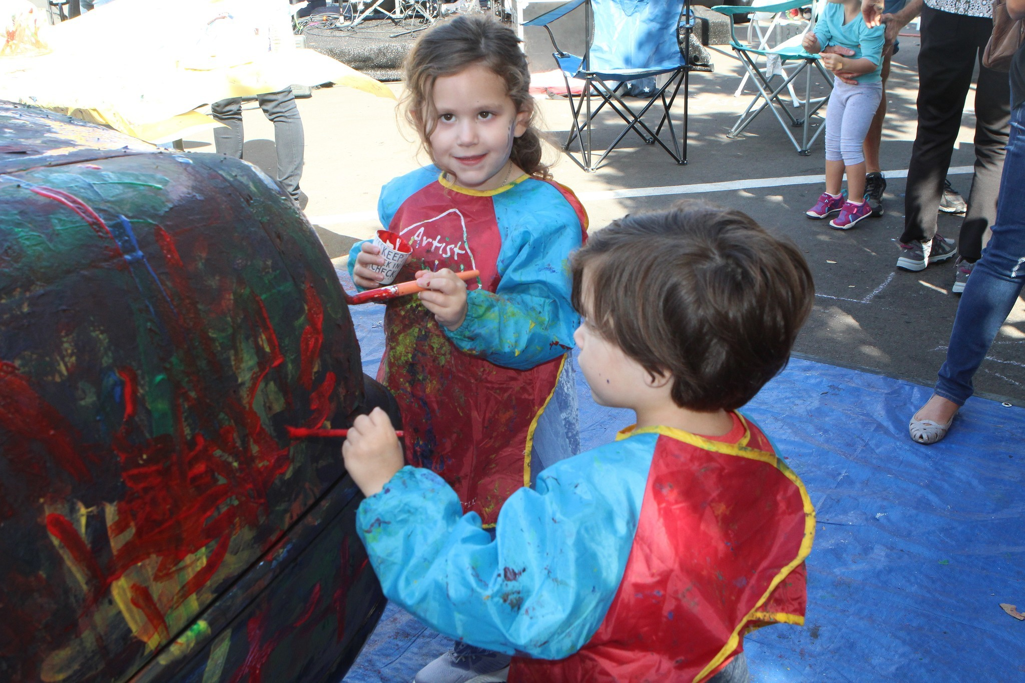 Emelia Jaron, 3, and her twin brother Nixon paint a limousine — an attraction offered every year.