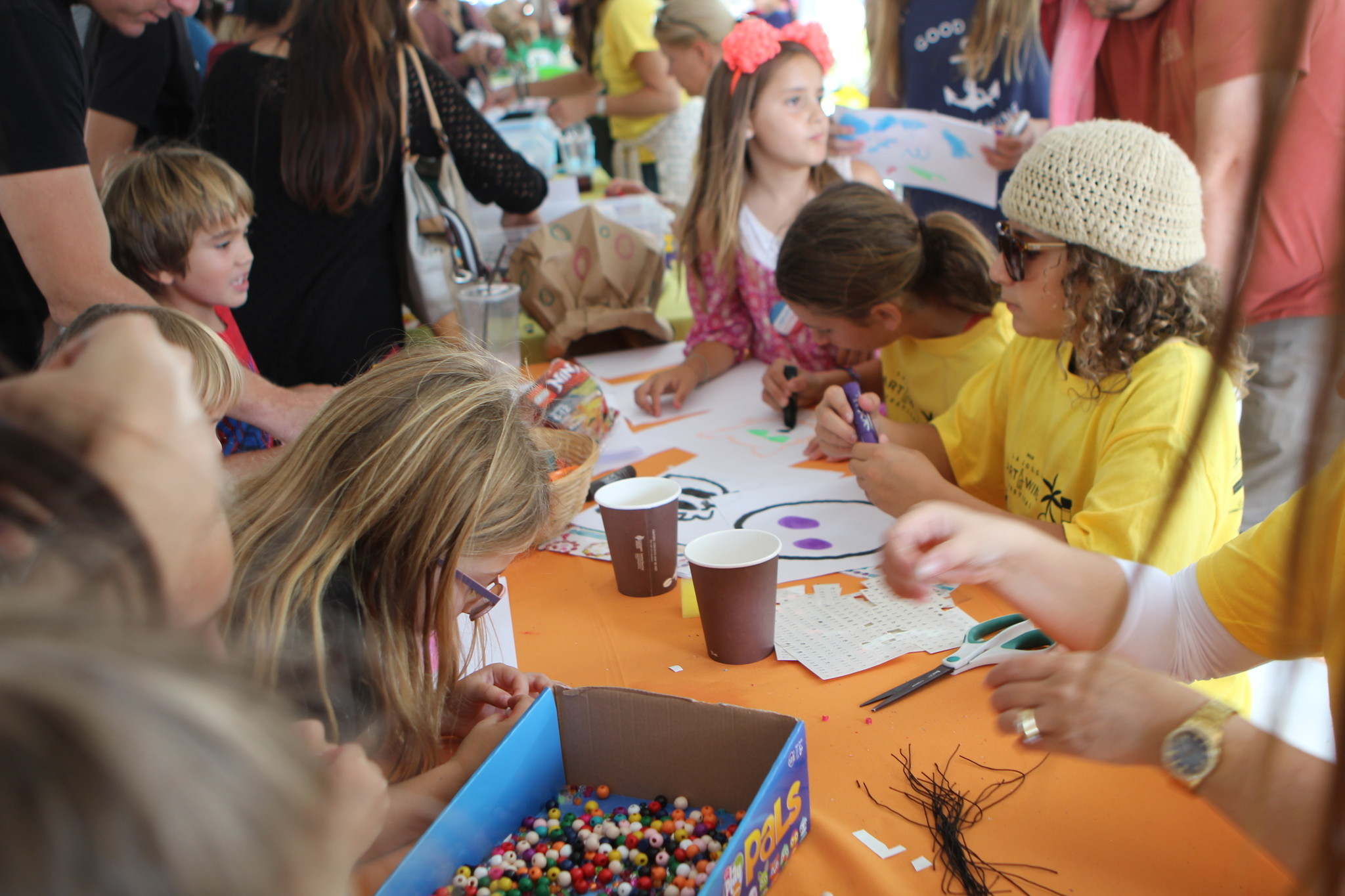 Children paint and make toy jewelry at the Geppetto's Family Art Center + Lab.
