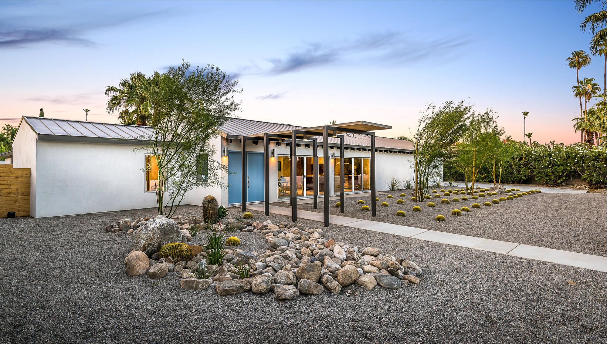 Former Palm Springs mayor's stylish residence elects for a list price of $2.4 mi...