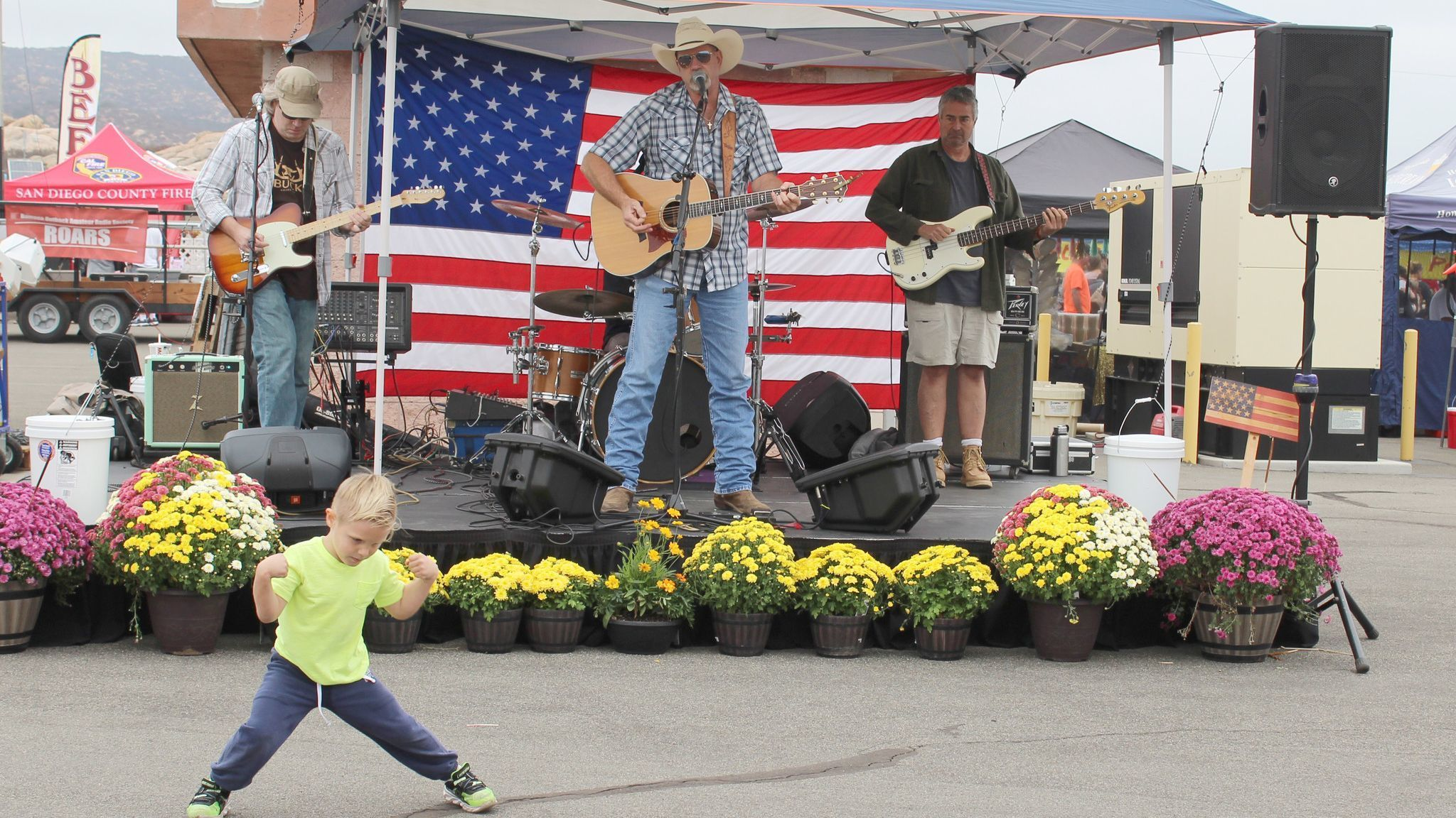Four-year-old Ramona resident Curren Lamont dances to the tunes of the Southbound Jonny band at the Air Fair.