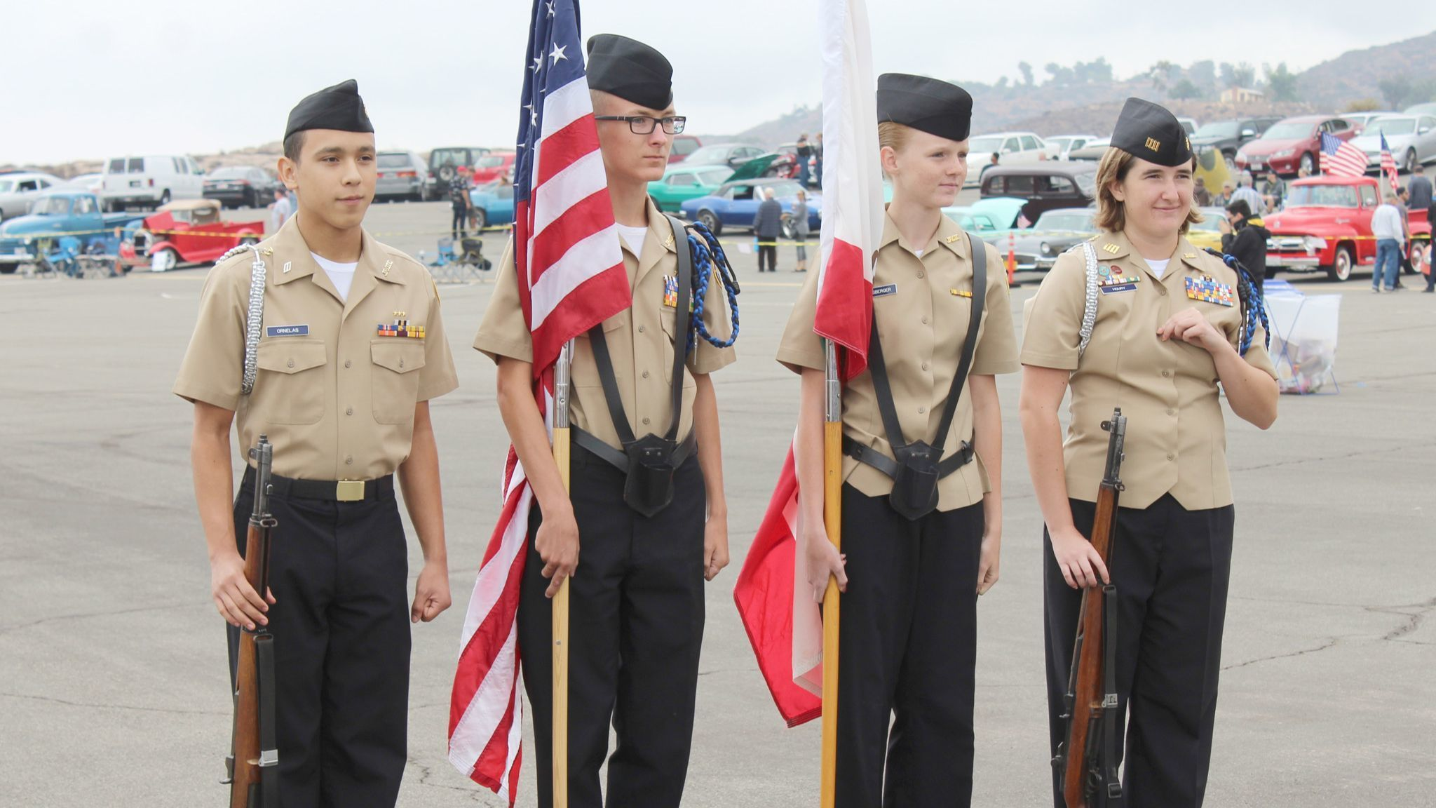 Ramona High School Navy Junior Reserve Officers Training Corps cadets present the colors. From left are: Amado Ornelas, Jacob Mask, Megan Hunsberger and Marisa Houry.