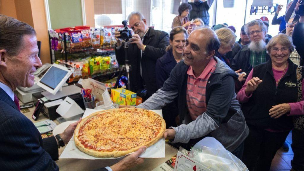 'Welcome Home' For New Britain Couple Means Laughs, Hugs, Pizza