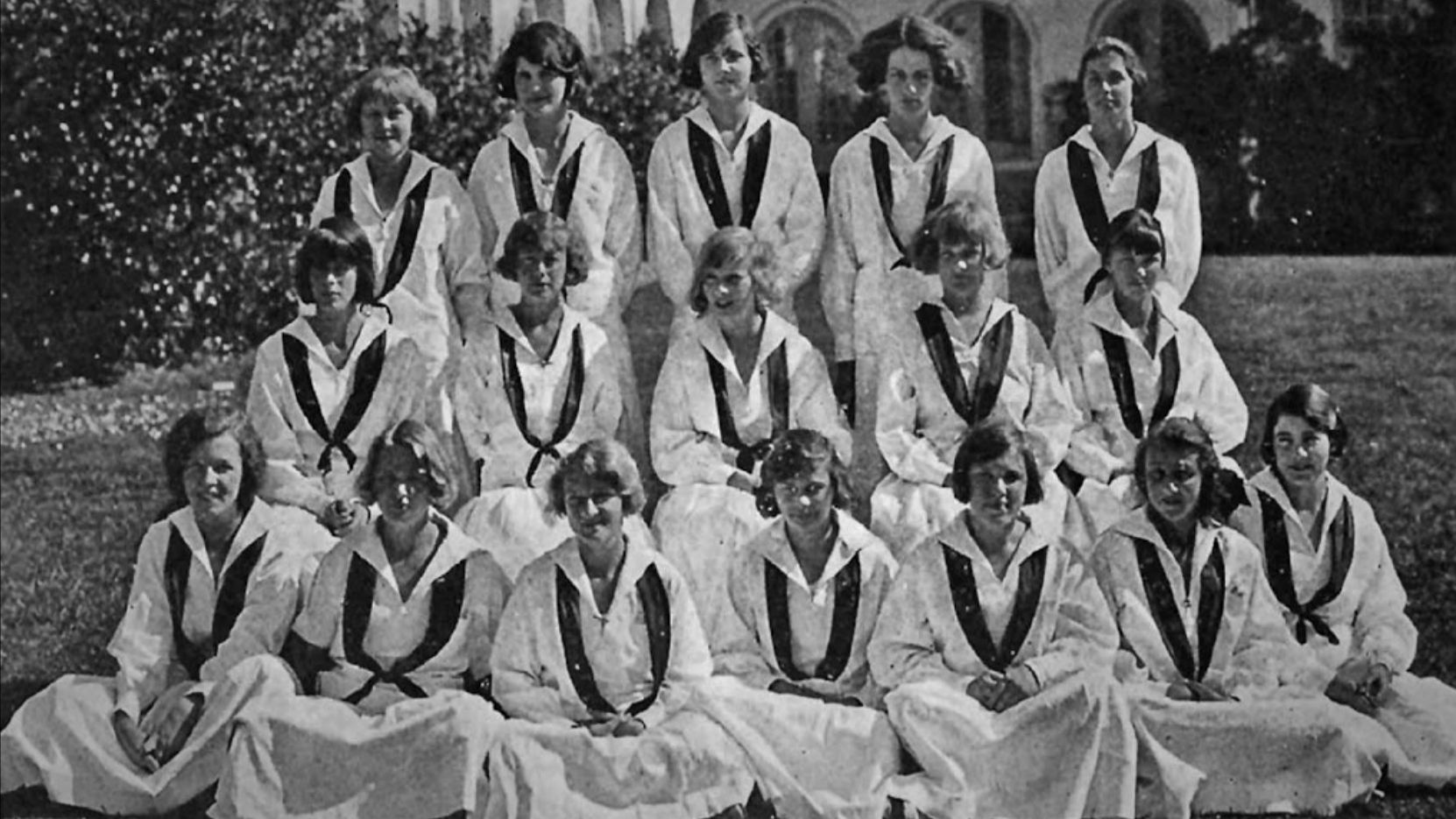 Peg, 15, appears in center of the middle row in this yearbook photo from the Bishop's School in 1923, looking off at something to her right.
