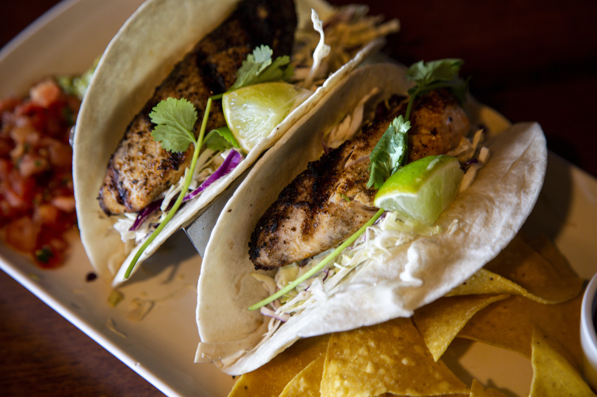 HONOLULU, HI - AUGUST 22: Tilapia Fish Tacos, served with Pico de gallo and chips, photographed at D