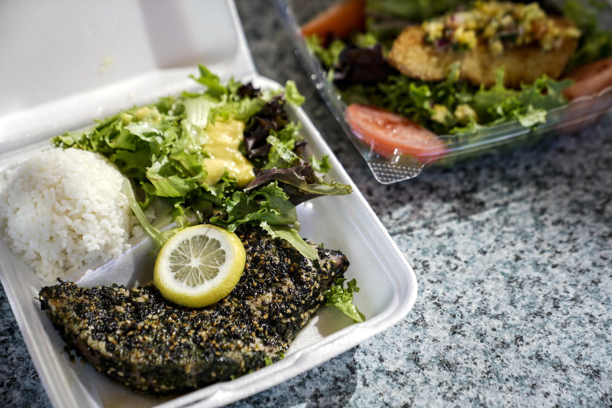 HONOLULU, HI - AUGUST 20: Furikake Pan Seared Ahi with rice and mixed greens, and panko crusted fish