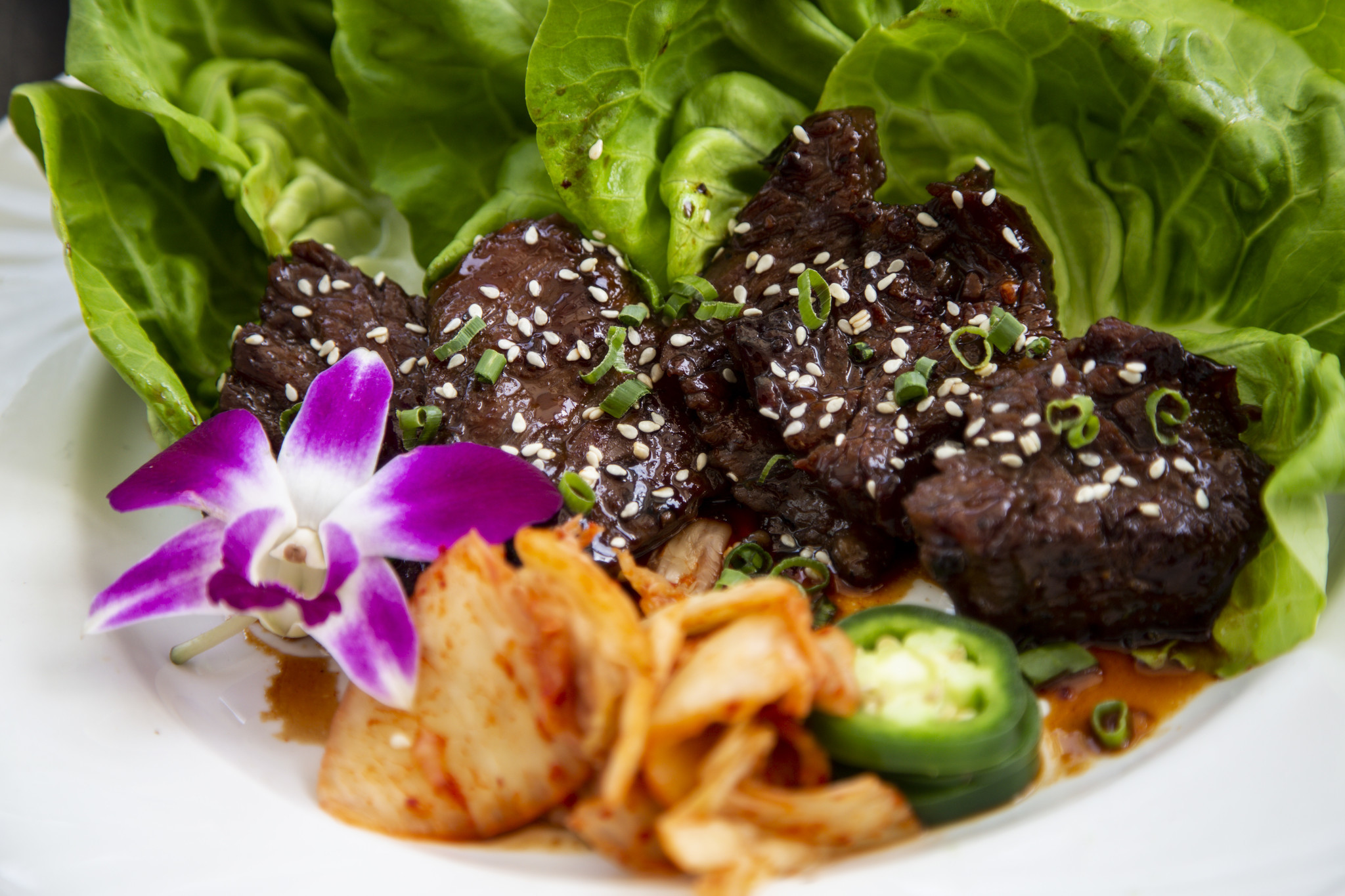 HONOLULU, HI - AUGUST 22: Kal-bi lettuce wraps, photographed poolside at Sheraton Princess Kaiulani