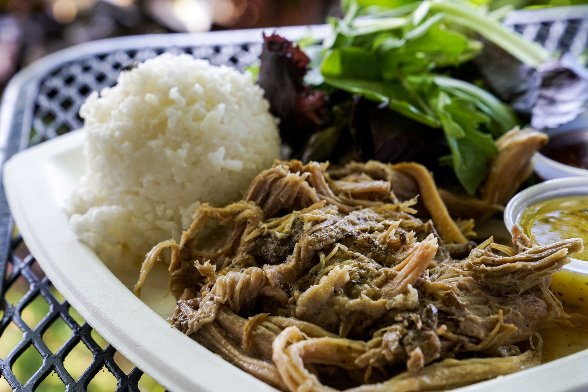 HALEIWA, HI - AUGUST 21: The Pork Plate Lunch, featuring 12-hour slow-roasted Kalua pulled pork, whi