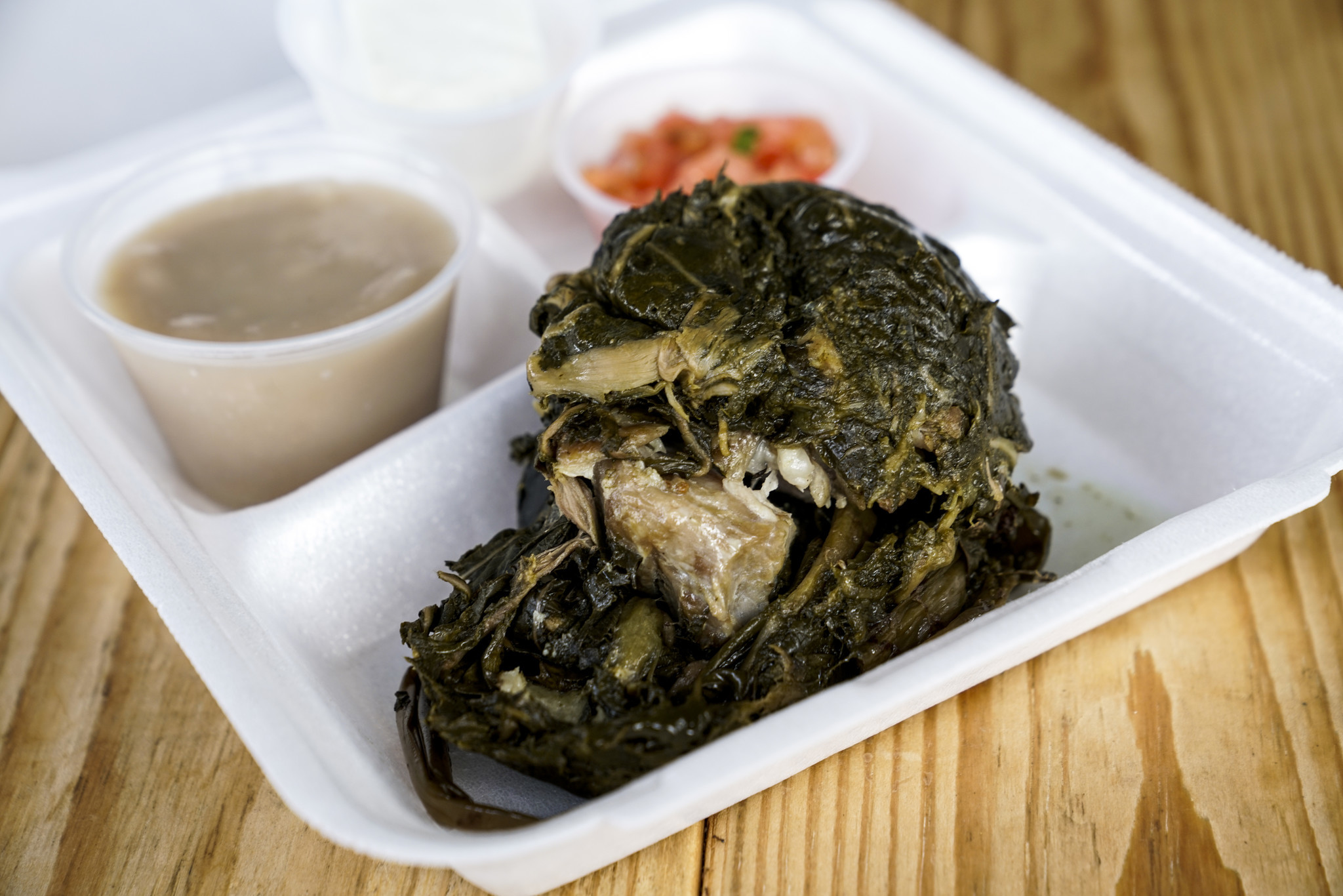 KANEOHE, HI - AUGUST 21: The Laulau combination plate, with Poi, Haupuia, and lomi salmon, photograp