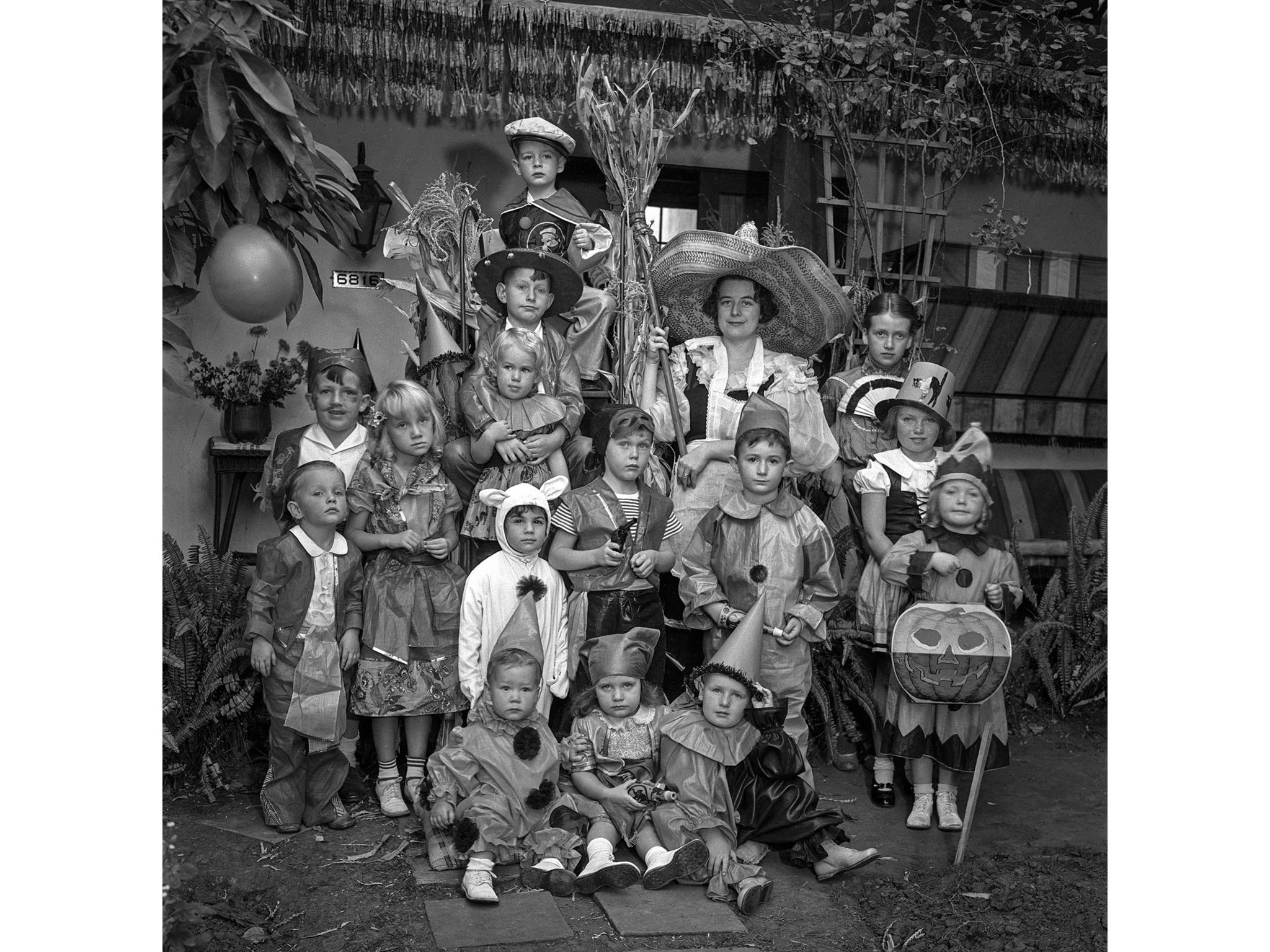 Oct. 31, 1935: Group photo of children in costume for Halloween party. The party was at the Hollywoo