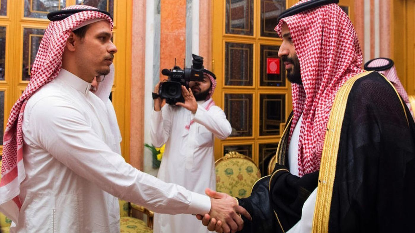 Saudi Crown Prince Mohammed bin Salman, right, shakes hands with Salah Khashoggi, son of Jamal Khashoggi.