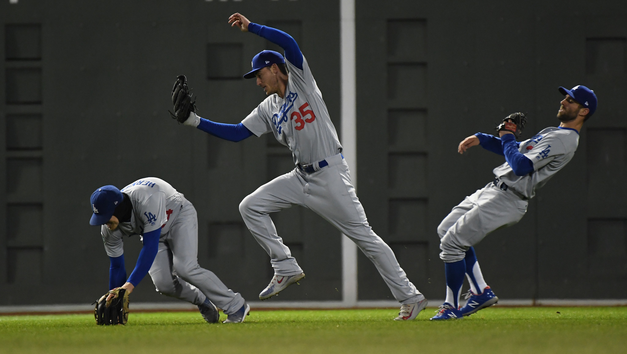 BOSTON, MA WEDNESDAY, OCTOBER 24, 2018 Dodgers Cody Bellinger makes a leaping catch as teammates E