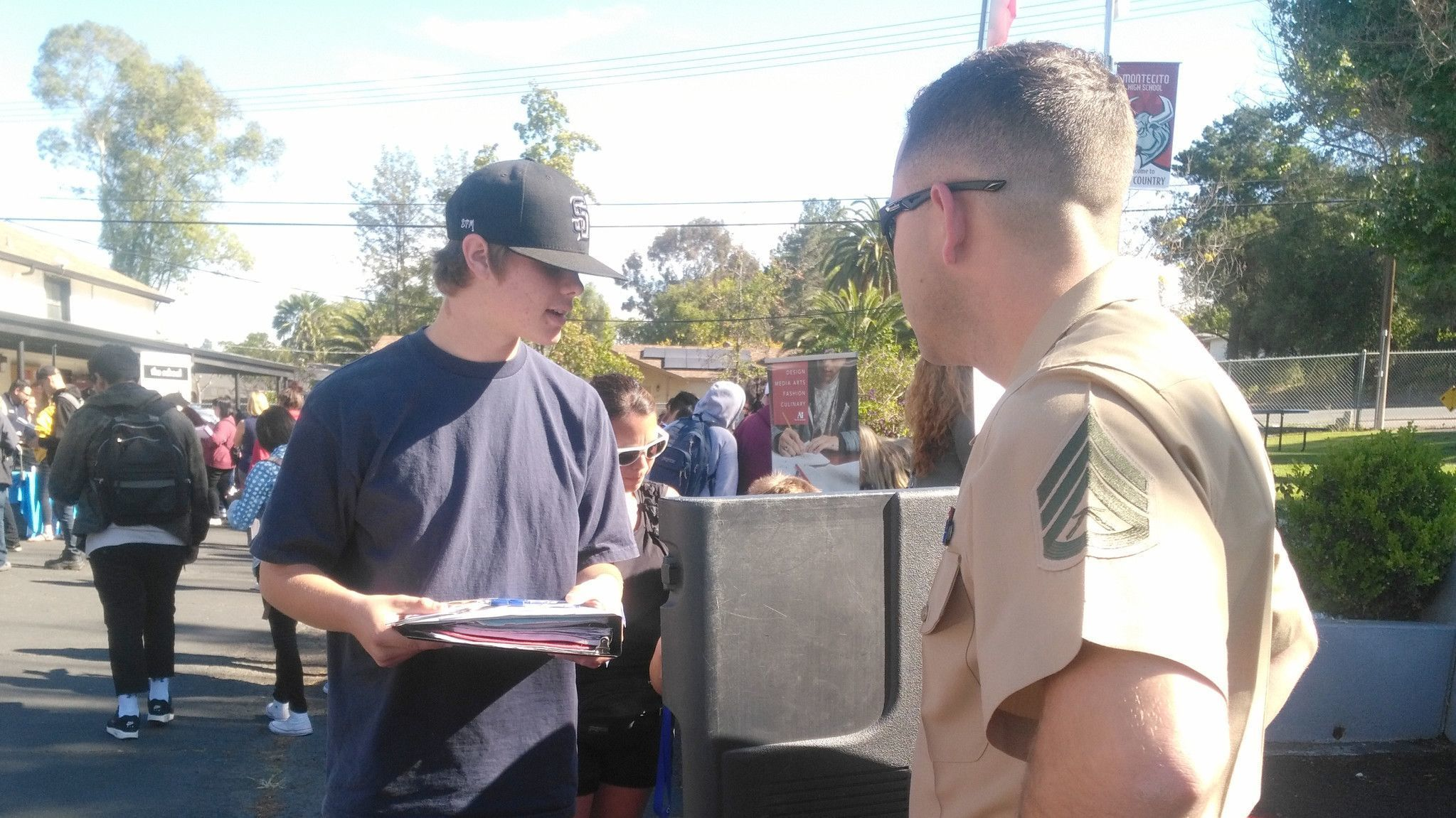 Montecito High senior Chase Blessum discusses plans to join the Marine Corps after graduation with Staff Sgt. Garrett Osborn.