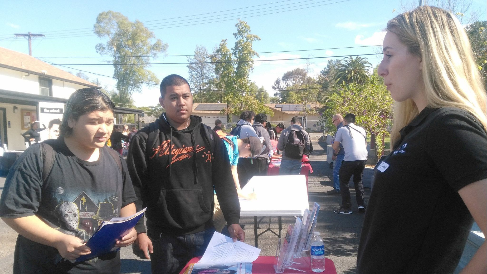 Montecito High students, from left, juniors Oscar Alvarado and Michael Flagg, explore community college options with Palomar College Ambassador Emma Combs.
