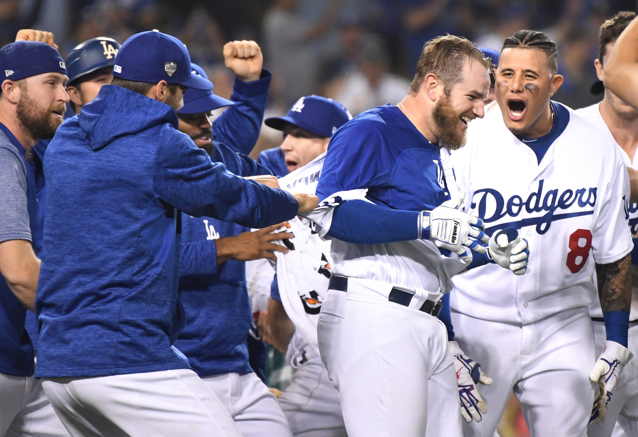 LOS ANGELES, CALIFORNIA , OCTOBER 26, 2018-Dodgers Max Muncy's, second from right, celebrates his wa
