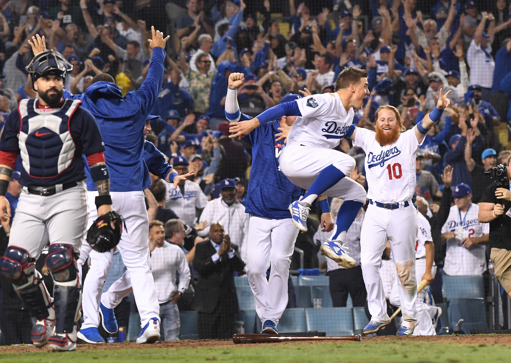 LOS ANGELES, CALIFORNIA , OCTOBER 26, 2018-Dodger players celebrate MaxMuncy's walk-off home run aga
