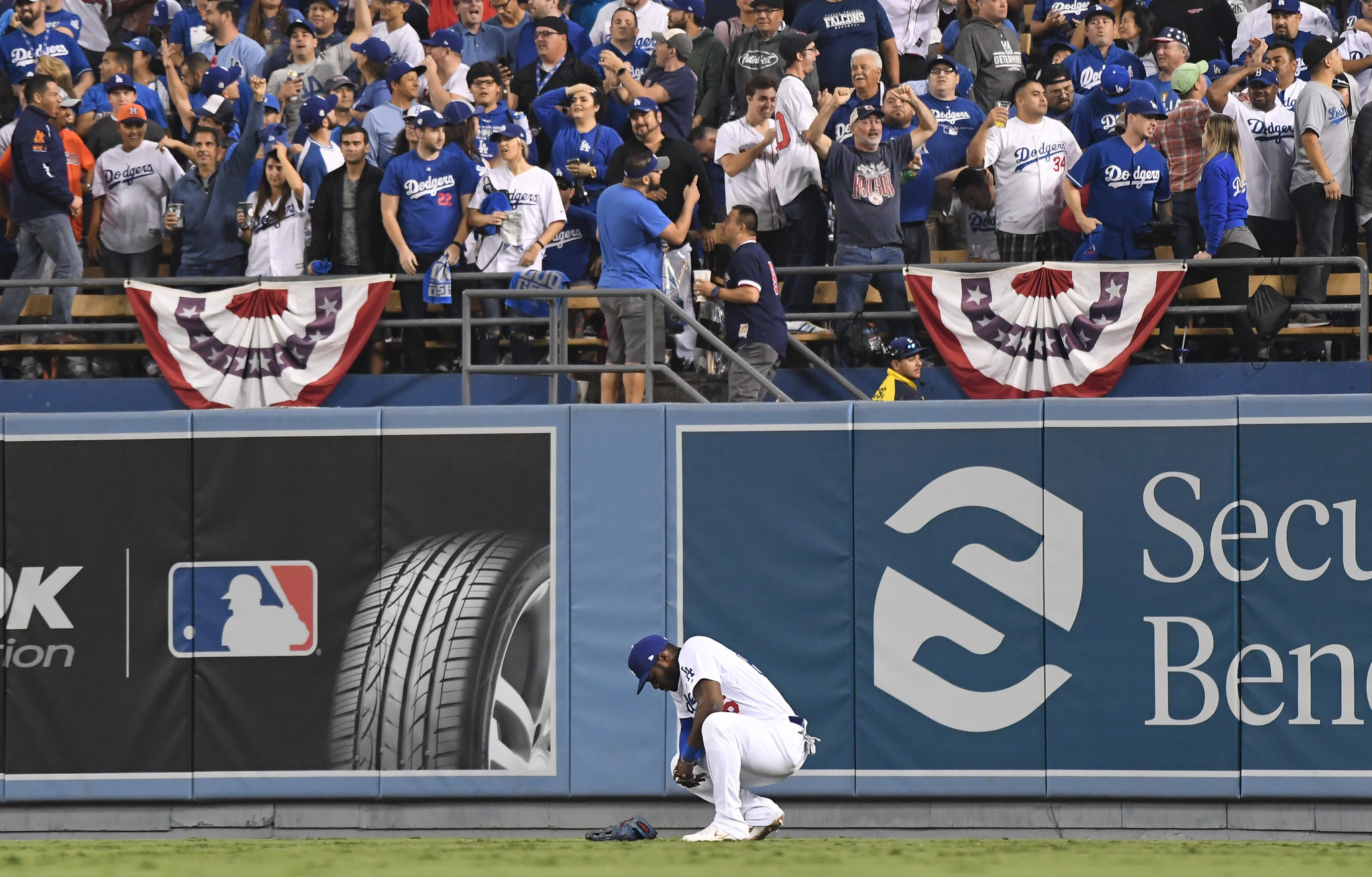 LOS ANGELES, CALIFORNIA , OCTOBER 27, 2018-Dodgers Yasiel Puig reacts after Red Sox hitter Mitch Mor