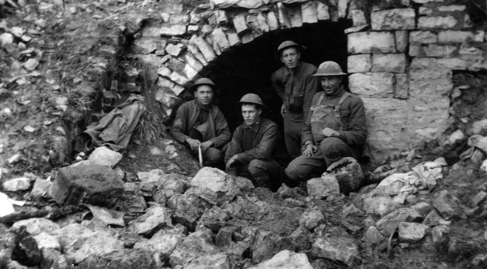 1918: California soldiers with the U.S. Army 91st Division in captured German dugout in Very, France