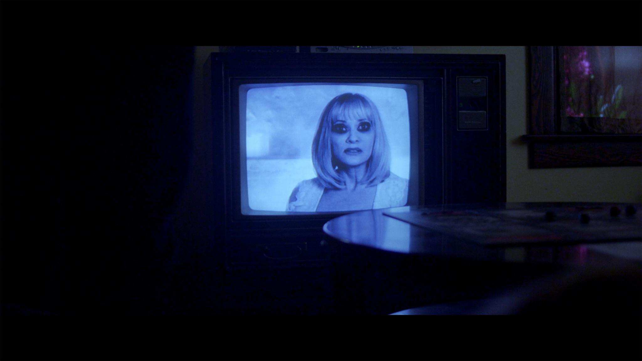 "Barbara Crampton as Evelyn in ""Beyond the Gates."" Credit: IFC Midnight"
