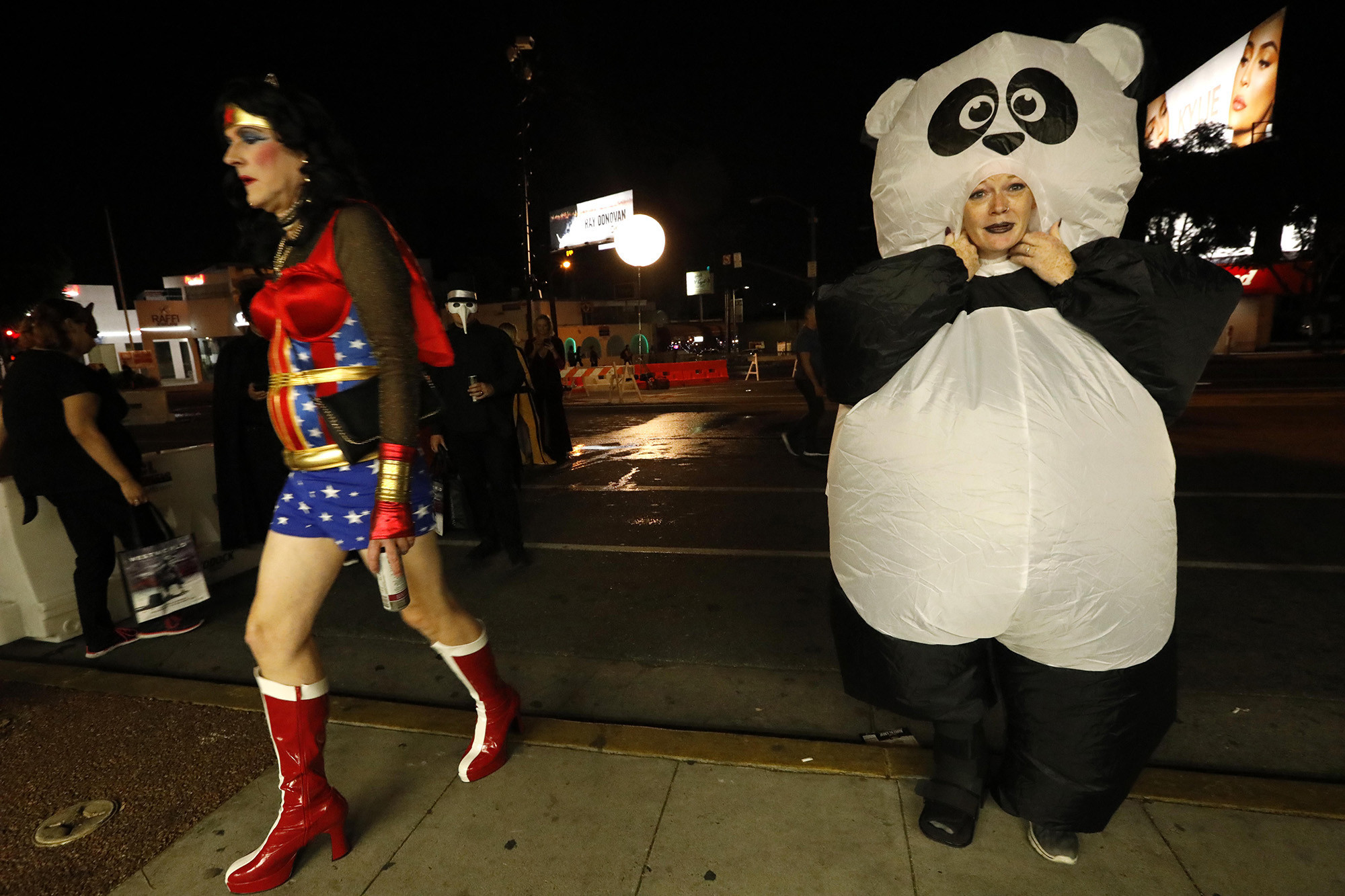 WEST HOLLYWOOD, CA – OCTOBER 31, 2018 - - Kathryn Anderson, dresses as a panda, while Wonder Woman w