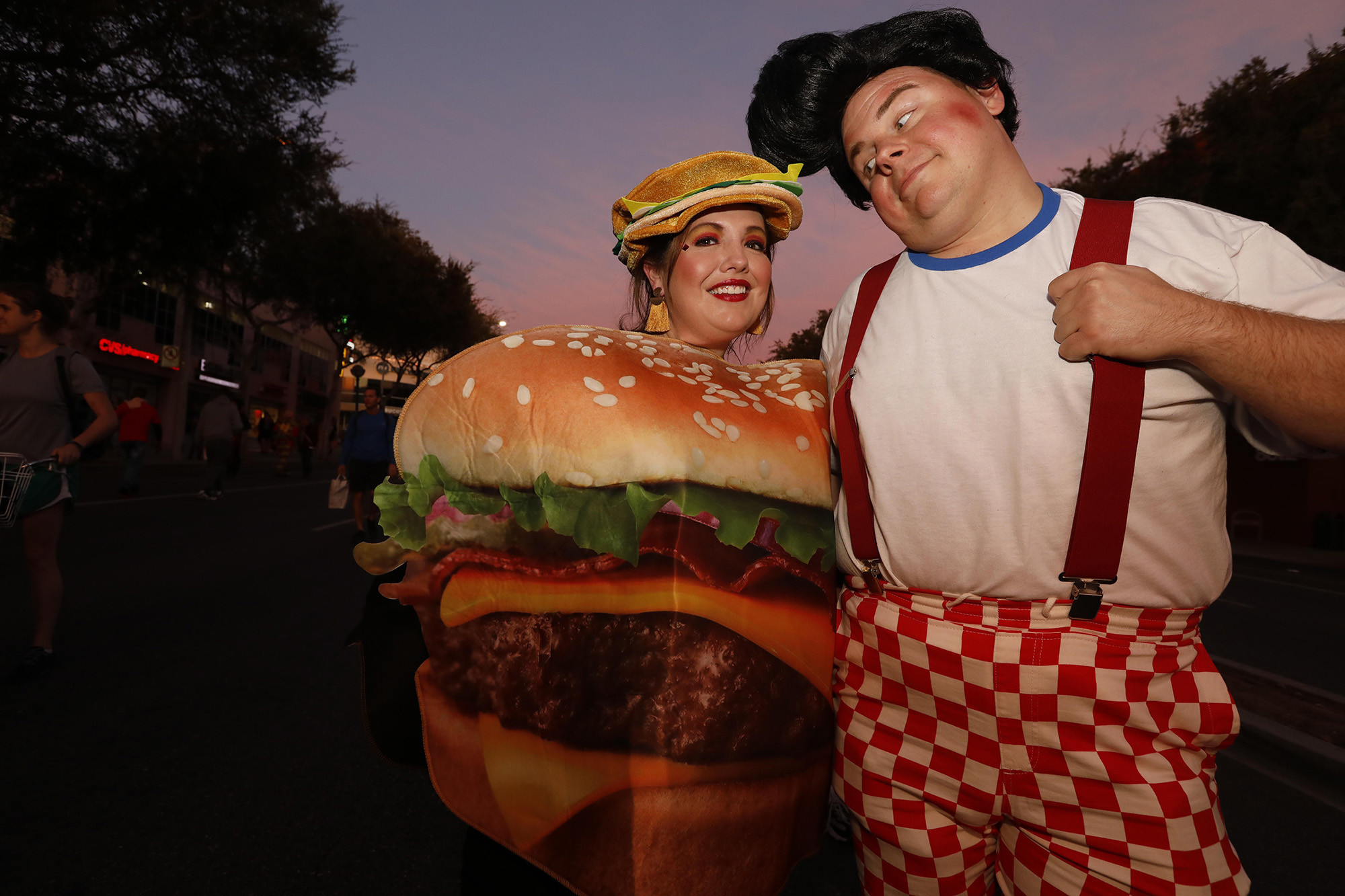 WEST HOLLYWOOD, CA – OCTOBER 31, 2018 - - Stephanie Dobies, dressed as a hamburger, and Aaron Marsh,