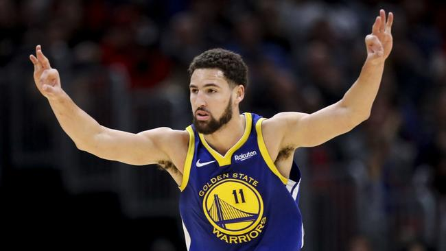 99571c62ea51 Warriors guard Klay Thompson celebrates after making a three-point-goal  basket the first half against the Bulls at the United Center on Oct. 29