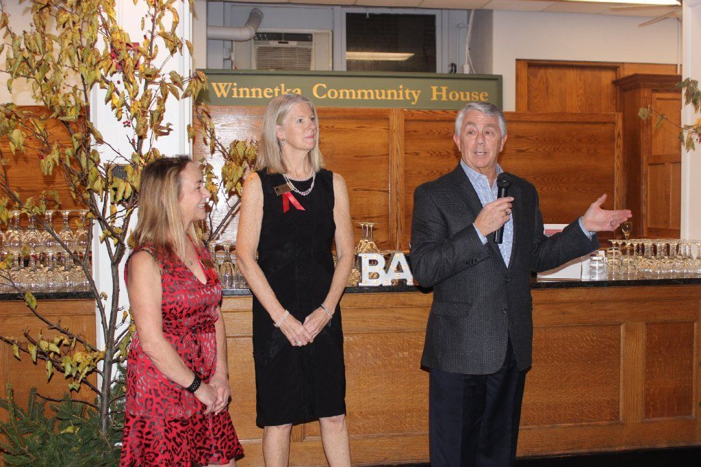 Co-chairs Annie Challenger and Cindy Monnig during opening remarks by Bob Thomas, president and CEO of the Winnetka Community House.