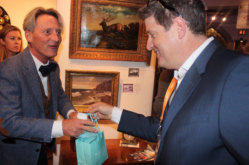 Jeff Harting of Highland Park makes a purchase from Trace Mayer of Trace Mayer Antiques of Louisville, Kentucky.