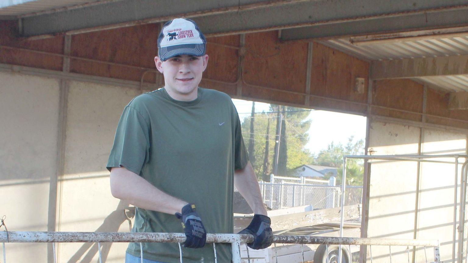 Ramona FFA member Zachary Padilla relocates a fence.