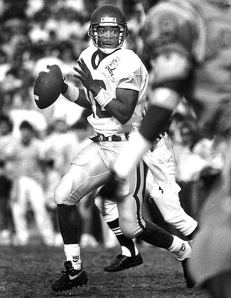 USC quarterback Rodney Peete looks downfield to pass in the 2nd quarter.