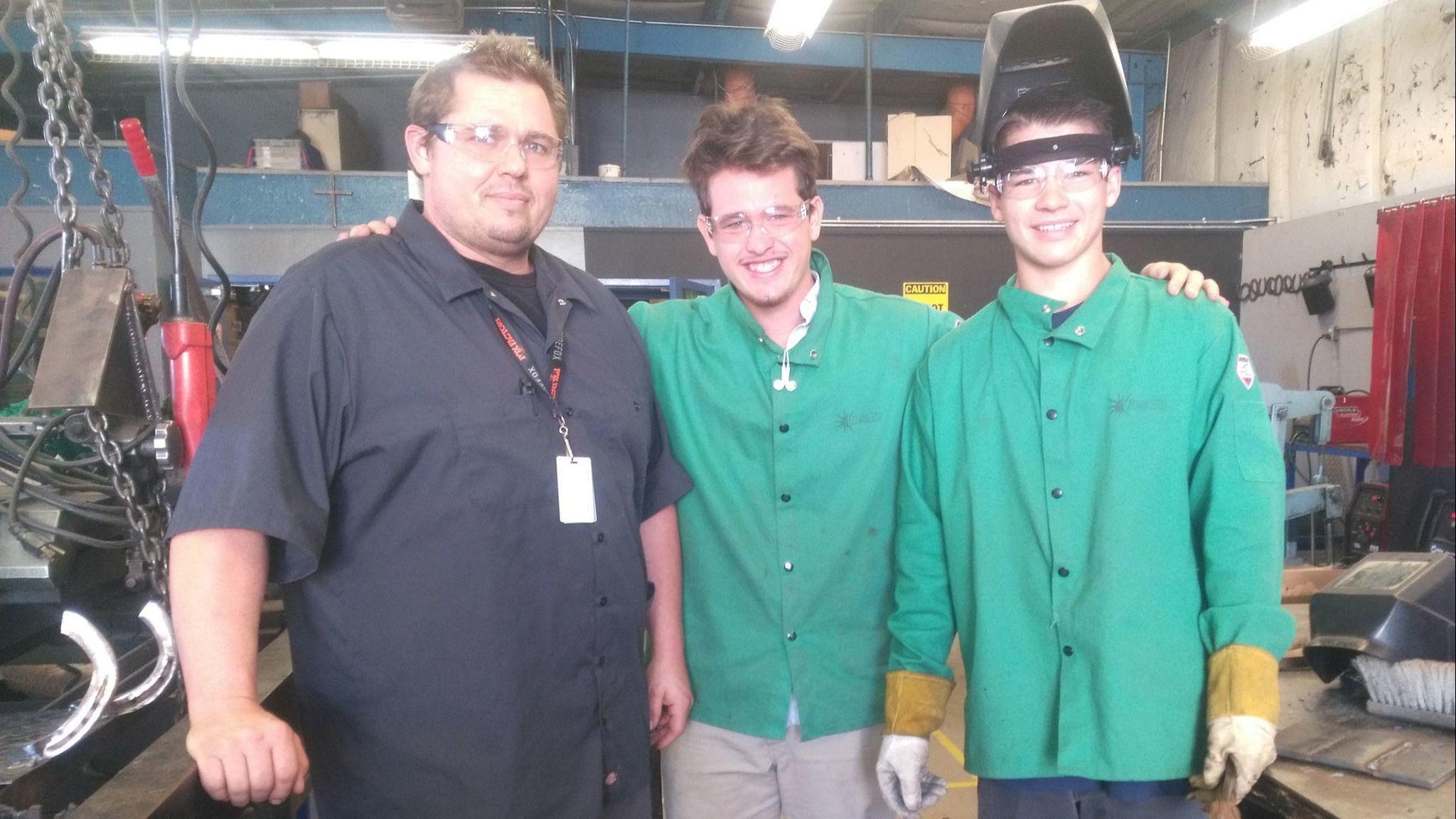 First-year Ramona High welding teacher Matthew Funkhouser trains students Sean Morgan, left, a junior, and Kyle Dodd, a senior.