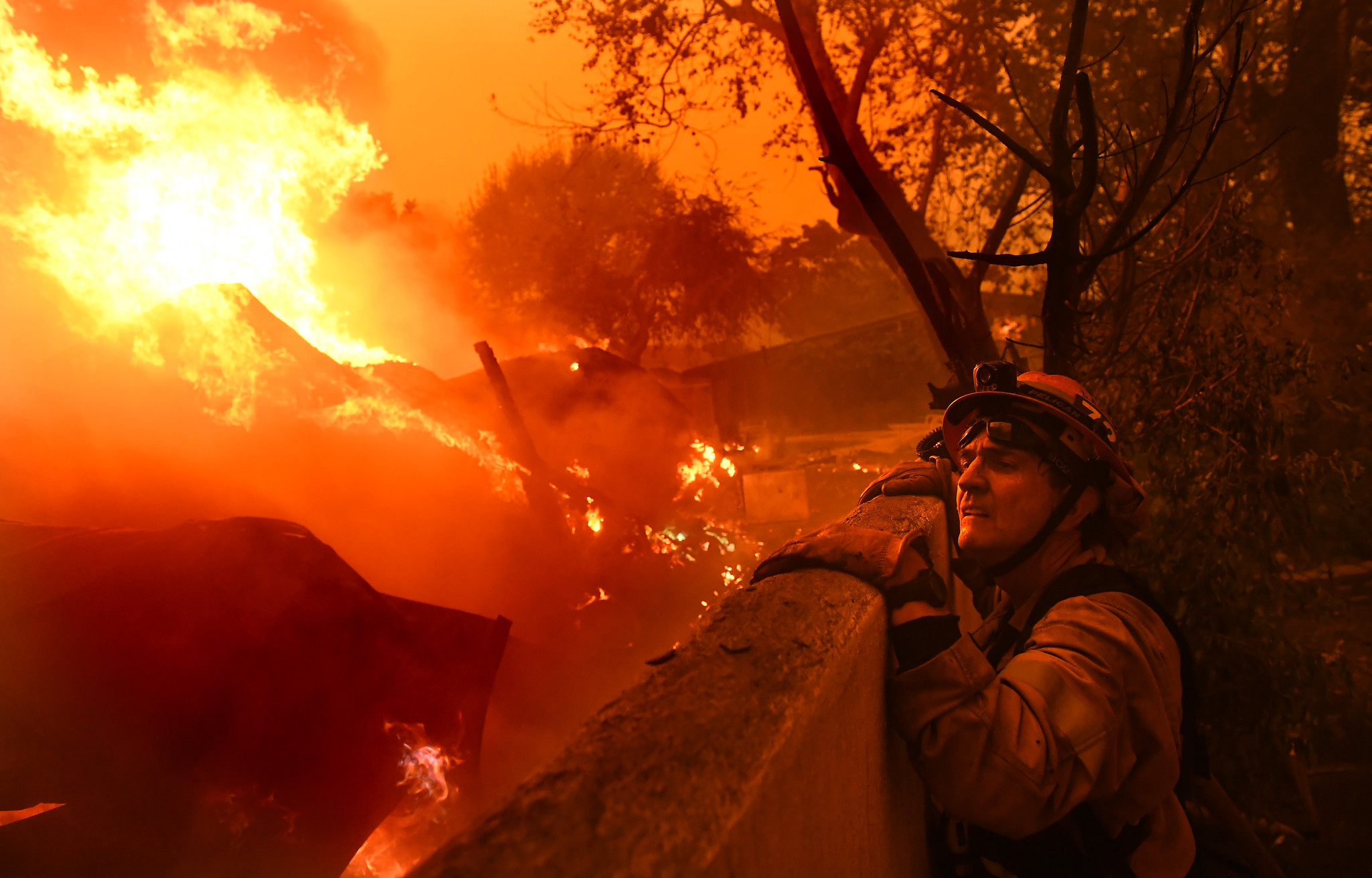 MALIBU, CALIFORNIA NOVEMBER 9, 2018-Mayor and firefighter Rick Mullen surveys a house that is on fir
