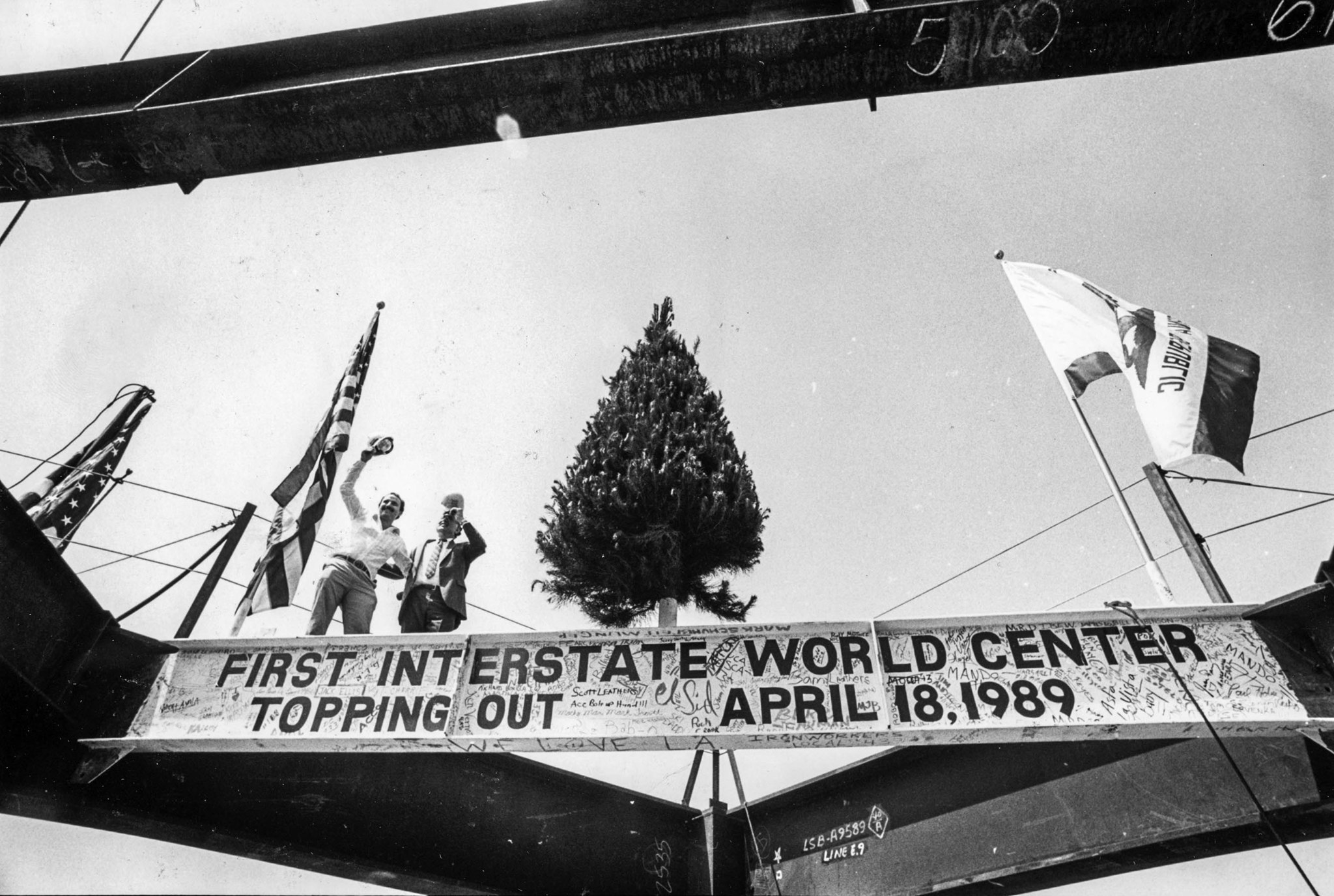 April 18, 1989: Two visitors wave during topping off ceremonies for the 73-story Library Tower, also