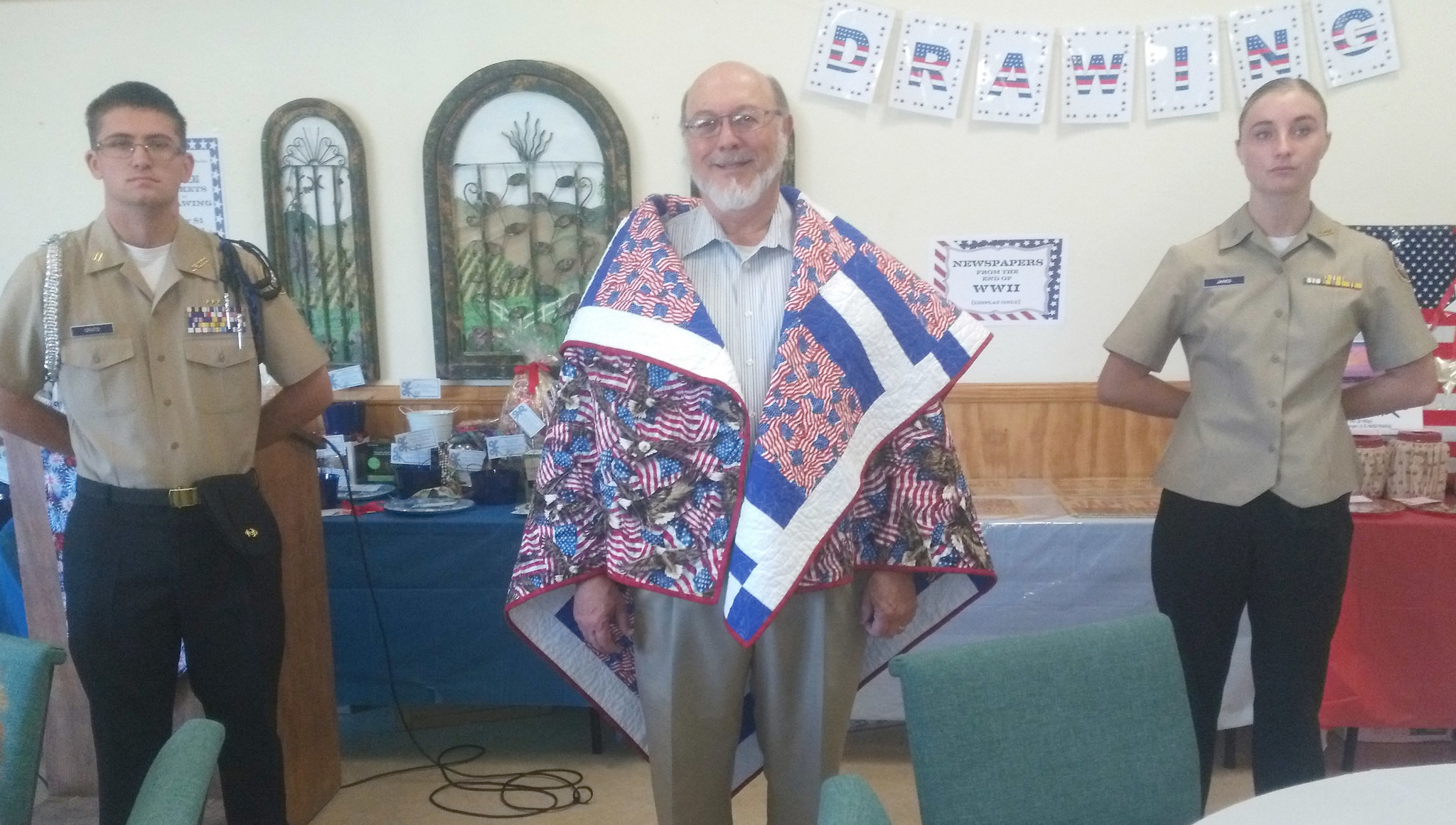 U.S. Navy Vietnam War veteran Steven Edward Breight is draped in a quilt created by the Rancho Bernardo chapter of Quilts of Valor Foundation to honor his military service.