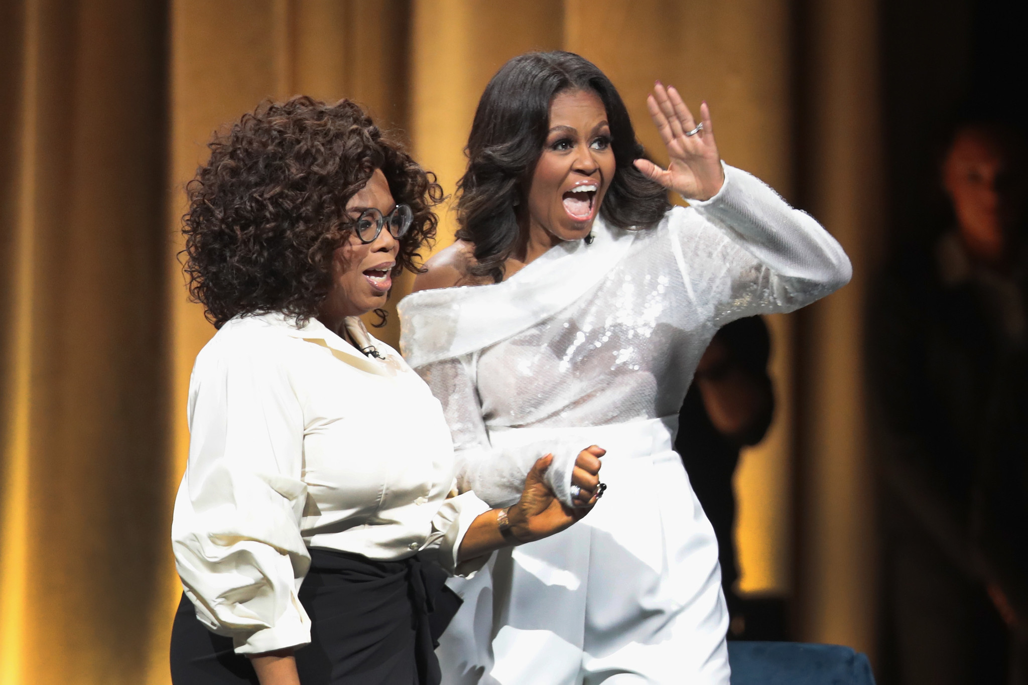 Michelle Obama steps out on book tour in boots Carrie