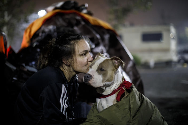 Brenda Wilson, who had just moved to Magalia from Chico before the Camp fire, kisses her dog Scooby at the Chico evacuation center.