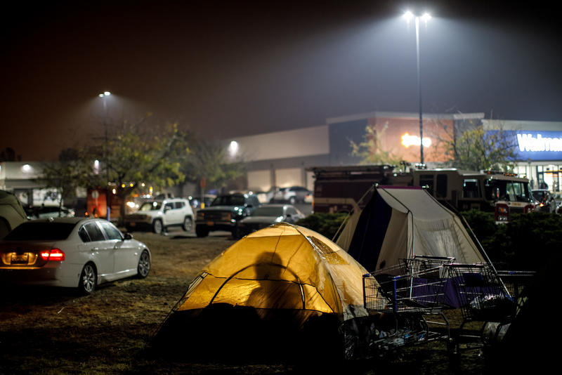 Evacuees from the Camp fire are taking shelter in tents and their vehicles in a Walmart parking lot in Chico.