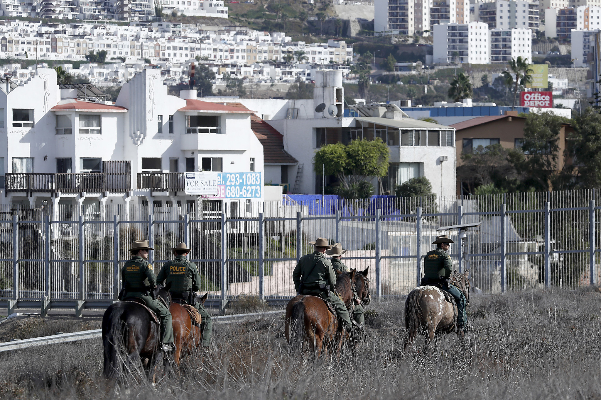 IMPERIAL BEACH, CALIF.. - NOV. 14, 2018. U.S. Botder Patrol officers patrol on horseback near the b