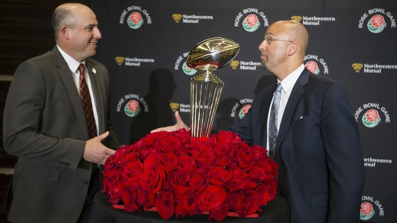 Penn State head coach James Franklin, right, greets Southern California head coach Clay Helton durin