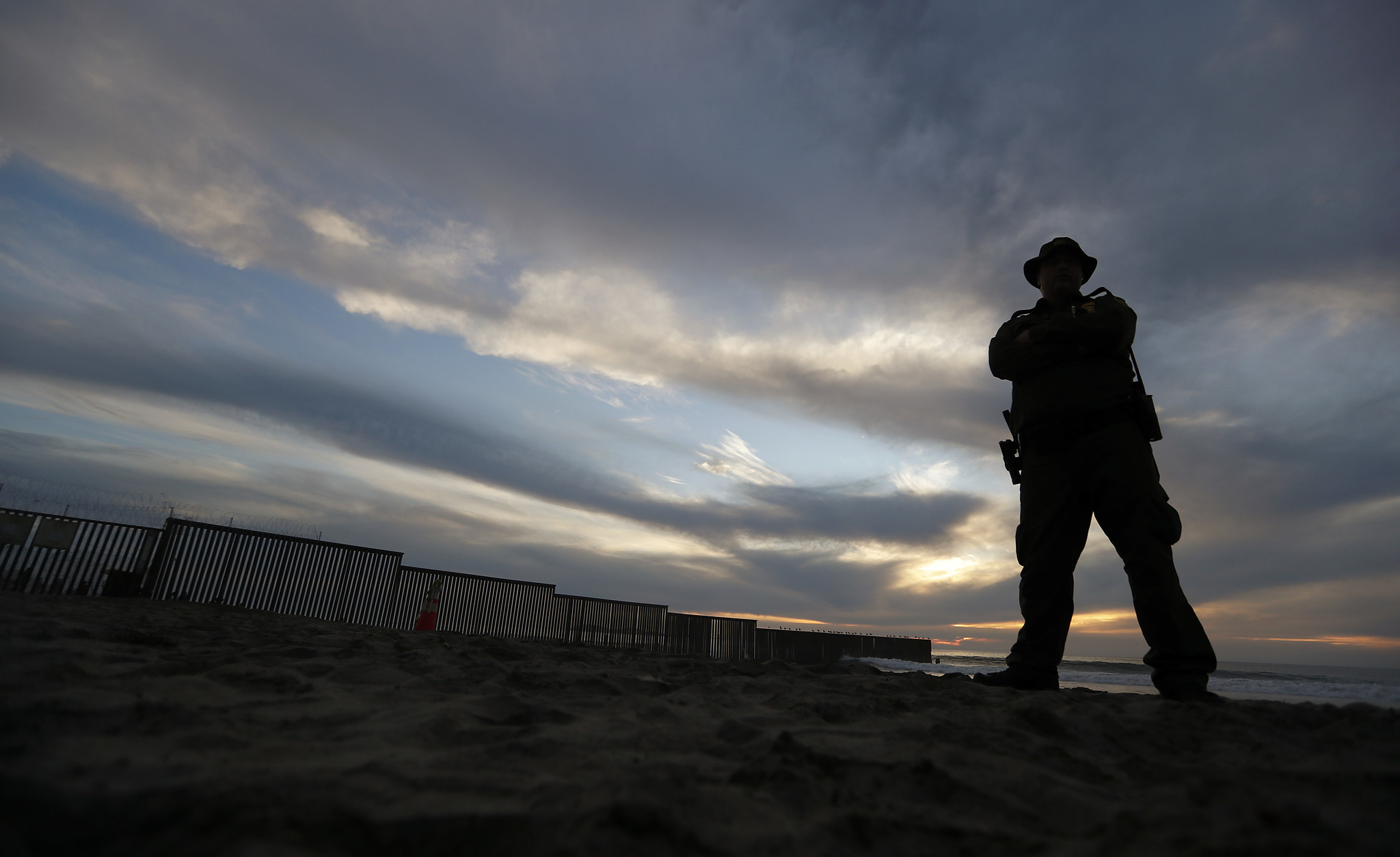 IMPERIAL BEACH, CALIF. . - NOV. 167 2018. A Border Patrol officer stands watch near the border wall