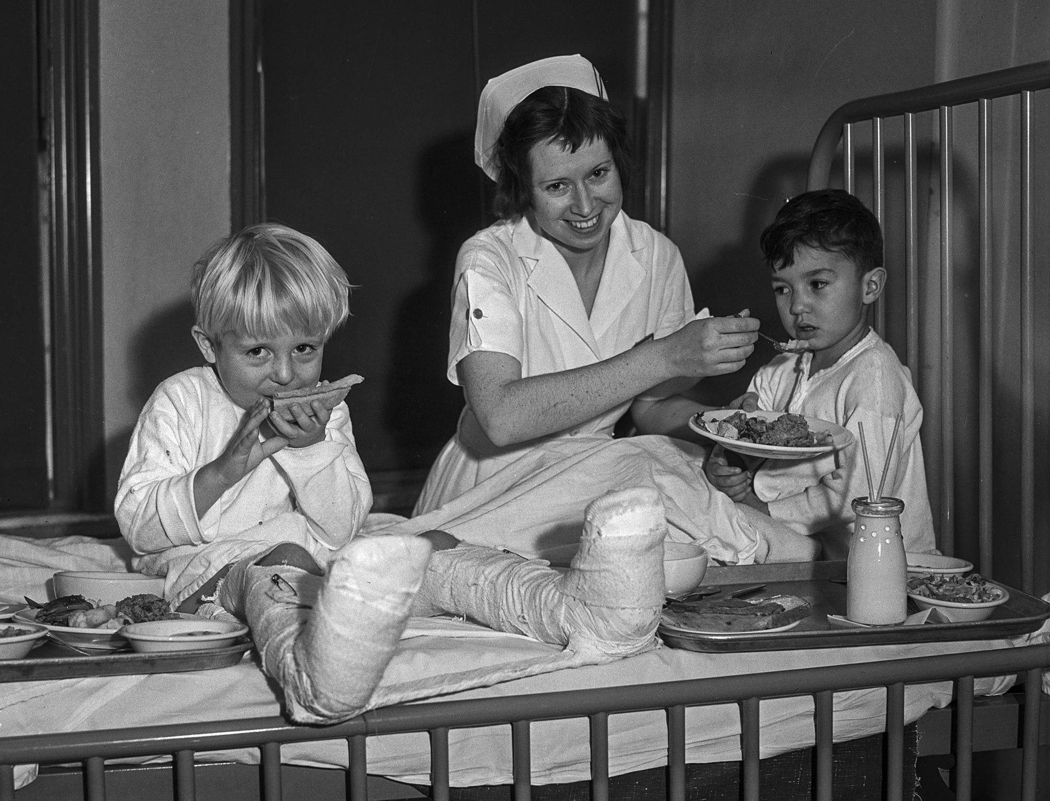 Nov. 28, 1935: Gordon Douglas, left, and Rupert Ortego are served Thanksgiving dinner by nurse Dorothy B