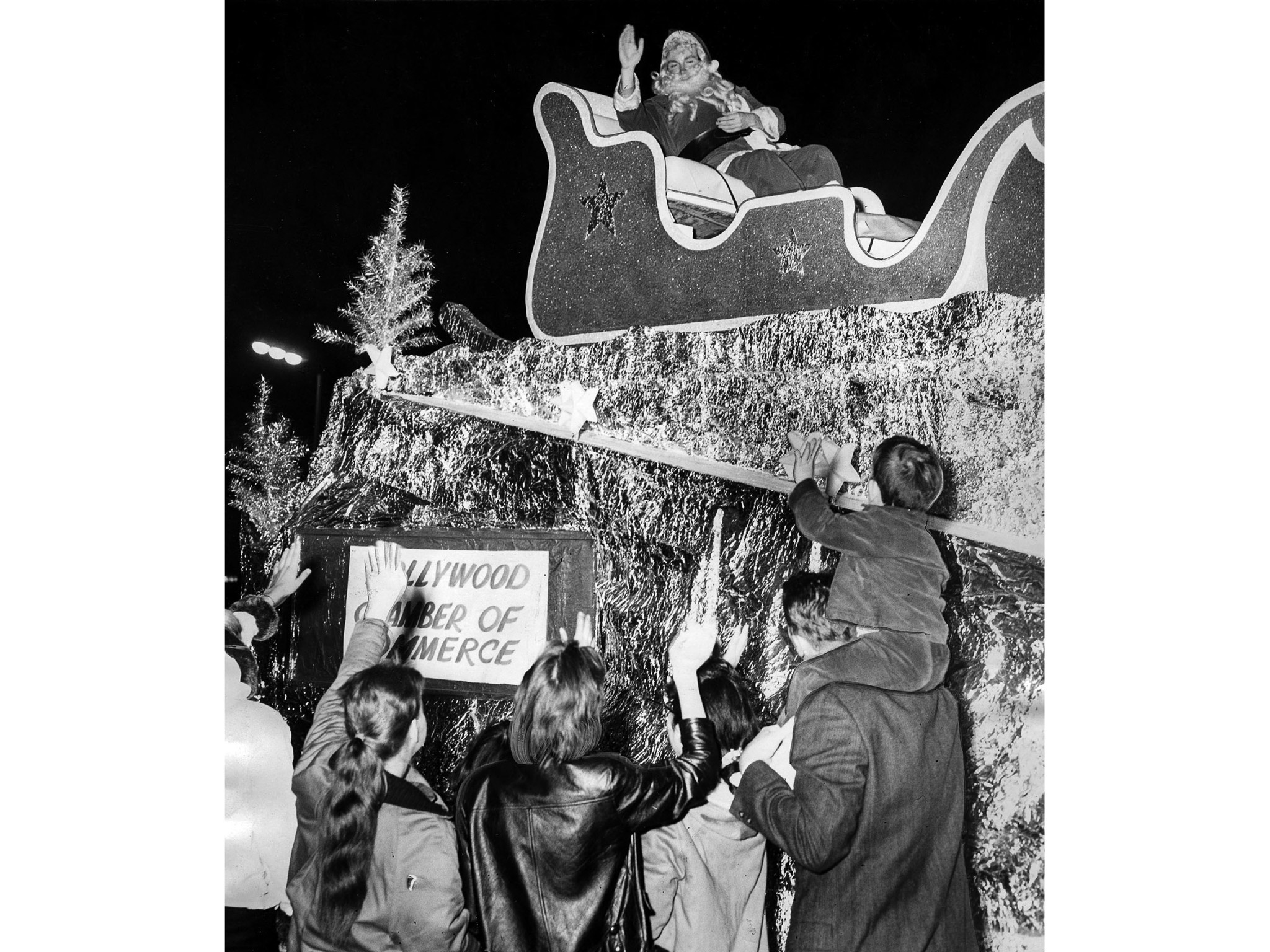 Nov. 23, 1960: Santa, actually actor Burt Lange, waves to the crowd during the Hollywood Santa Claus
