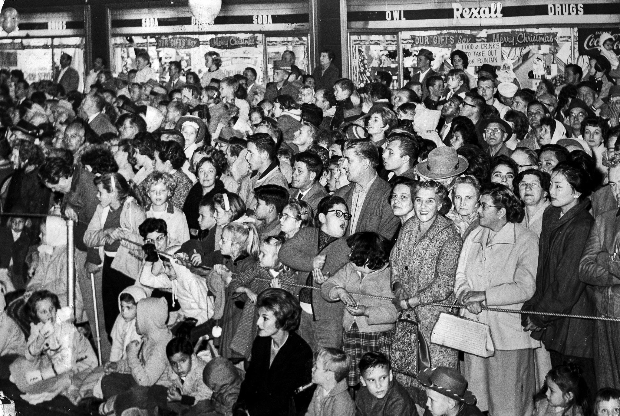 Nov. 22, 1961: Thousands of spectators gather to watch Santa Claus Lane parade file down Hollywood B