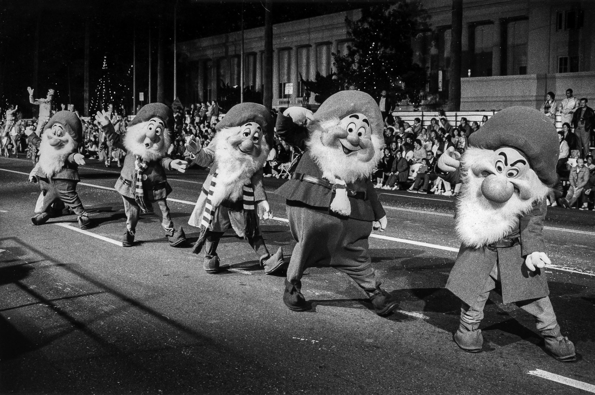 Nov. 27, 1988: Some of the Disney dwarfs march in the Hollywood Christmas Parade along Sunset Blvd.