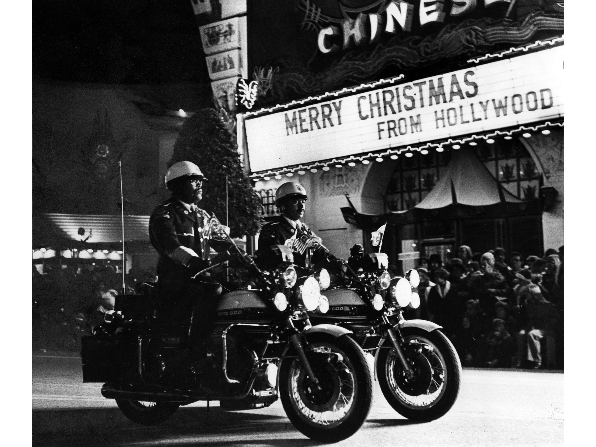Nov. 28, 1976: Members of the Los Angeles Police Department motorcycle drill team lead the Santa Cla