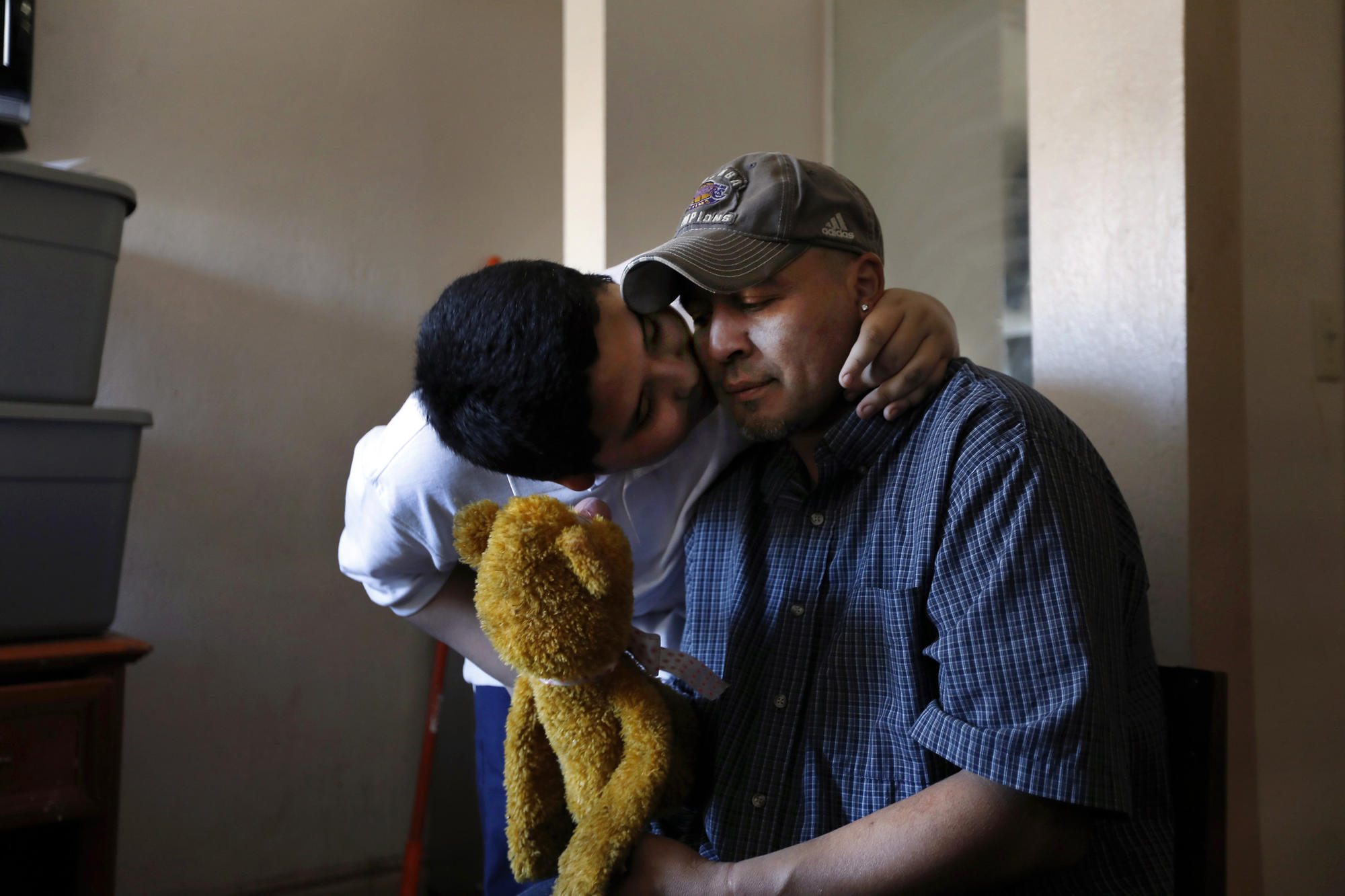 Angel hugs his father Jose